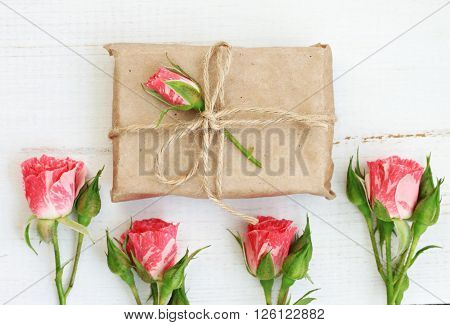 Handmade gift wrap idea, parchment paper, twine, decorated with delicate garden roses.