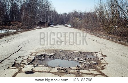 Large pit - on the suburban road