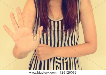 Young woman showing her denial with NO on her hand Vintage filtered image.