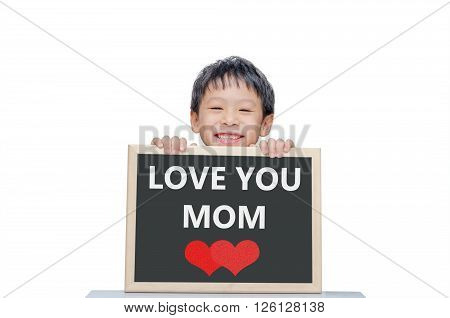 Young Asian boy smile with Love you mom on chalkboard over white background