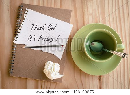 Thank god , It's Friday on paper note with empty coffee cup