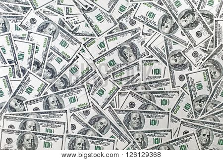 Background from a variety of one hundred dollar bills. Many dollars. Money background. Fake money.