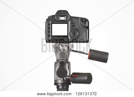 Camera on a tripod with white background