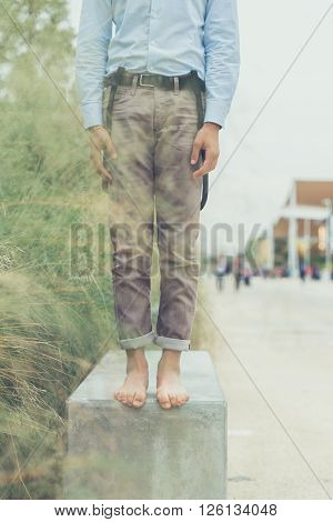 Detail Of A Young Man Posing In An Urban Context