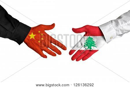 China and Lebanon leaders shaking hands on a deal agreement