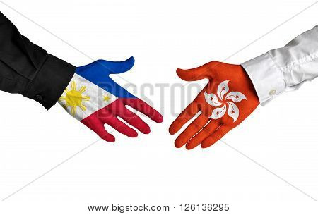 Philippines and Hong Kong leaders shaking hands on a deal agreement