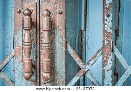 Steel door handles of the old blue sliding door (door, handle, vintage)