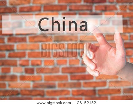 China - Hand Pressing A Button On Blurred Background Concept On Visual Screen.