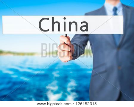 China - Businessman Hand Holding Sign