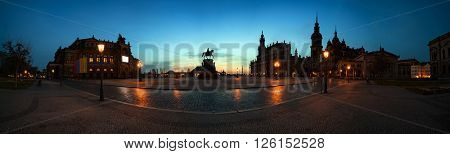 Panorama night summer view of Semper Opera House, Monument to King John and Hofkirche in Dresden, Saxony, Germany