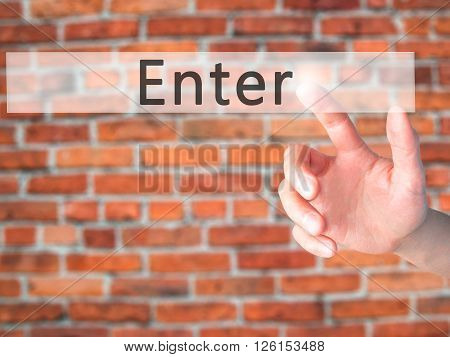 Enter - Hand Pressing A Button On Blurred Background Concept On Visual Screen.