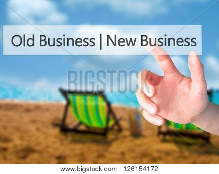 Old Business  New Business - Hand Pressing A Button On Blurred Background Concept On Visual Screen.