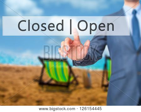 Open Closed - Businessman Hand Pressing Button On Touch Screen Interface.