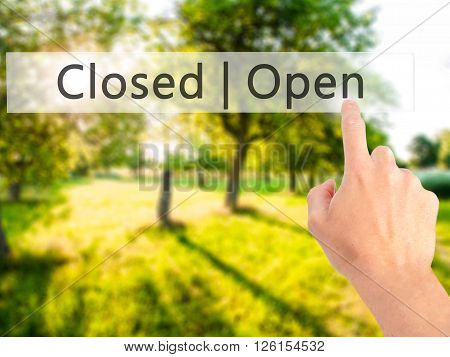 Open Closed - Hand Pressing A Button On Blurred Background Concept On Visual Screen.