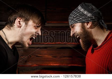 Confrontation. Conceptual photo. Two brutal man looking into each other's eyes