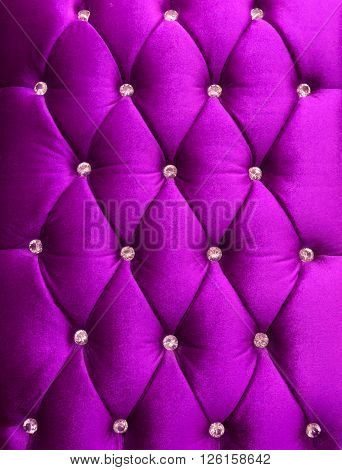 Purple upholstery velveteen decorated with crystals as texture and pattern