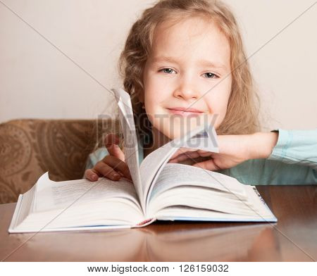 Girl doing homework. Child education