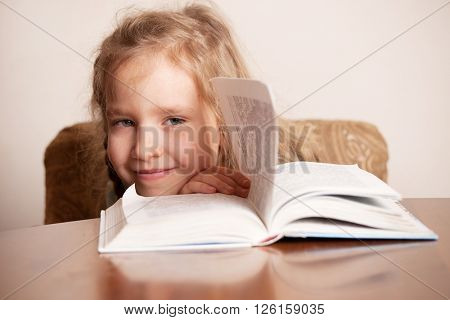 Girl with book. Child education