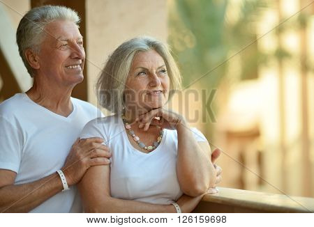 Portrait of a senior couple relaxing near  hotel resort