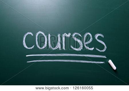 Courses inscription written with white chalk on blackboard