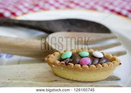 pastry with chocolate cream and colored sugared almonds