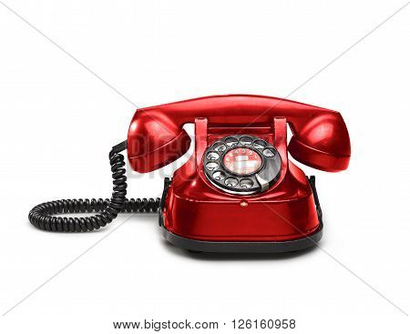 An old red telephon with rotary dial - clipping path
