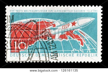 GERMAN DEMOCRATIC REPUBLIC - CIRCA 1961 : Cancelled postage stamp printed by German Democratic Republic, that shows  Earth and rocket ship.