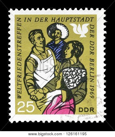 GERMAN DEMOCRATIC REPUBLIC - CIRCA 1969 : Cancelled postage stamp printed by German Democratic Republic, that shows workers.