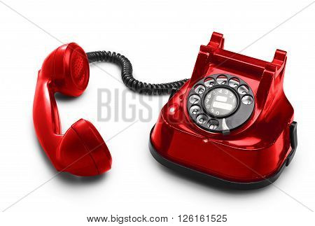 An Old Red Telephon With Rotary Dial