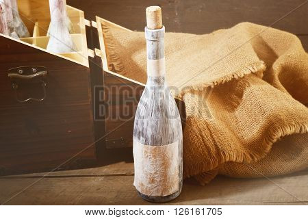 Aged wine bottles on wooden table in a wine cellar