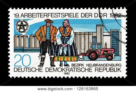 GERMAN DEMOCRATIC REPUBLIC - CIRCA 1982 : Cancelled postage stamp printed by German Democratic Republic, that shows Folklore and agriculture equipment.