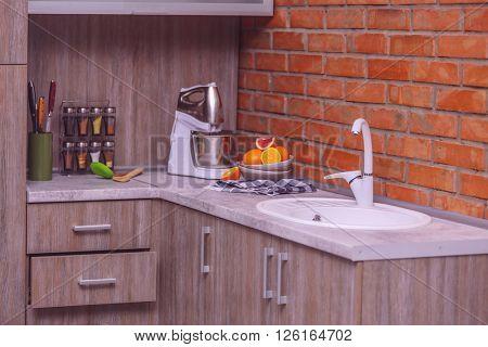Modern kitchen furniture with sink, mixer and utensils