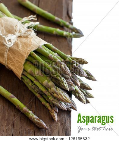 Fresh asparagus spears on a wooden table close up