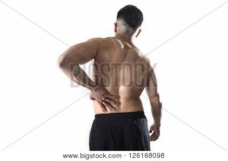 young muscular body sport man holding sore low back waist massaging with his hand suffering pain in athlete stress and health care concept isolated on white background