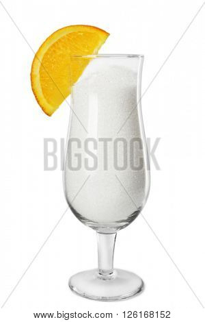 Hurricane glass with granulated sugar and slice of orange on grey background