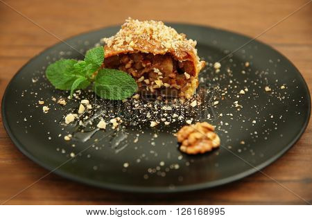 Piece of apple roll on a plate