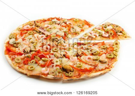 Sliced pizza with seafood, red pepper and green olives, isolated on white