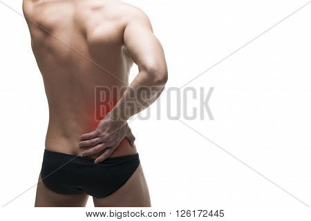 Kidney pain. Man with backache. Pain in the human body. Muscular male body. Isolated on white background with red dot
