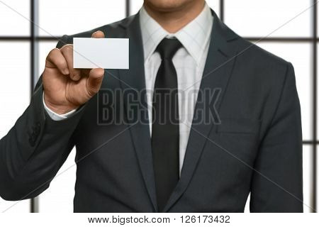 Businessman showing his visit card. Man holds blank visit card. Special guest has arrived. Best attorney in town.