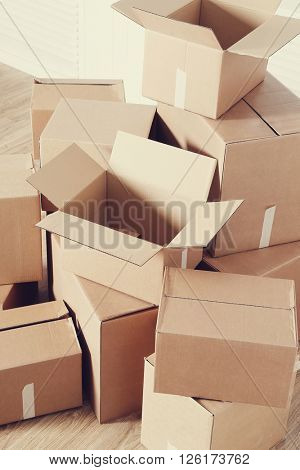 Moving home. Cardboard boxes on the floor