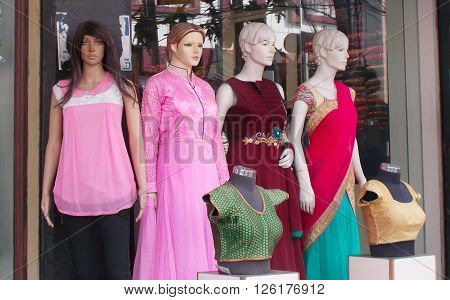 HYDERABAD,INDIA-APRIL 14:Mannequins dressed in latest Indian fashion in front of a retail clothes store on April 14,2016 in Hyderabad,India