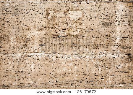 old wall with brown beige travertine surface - detail texture