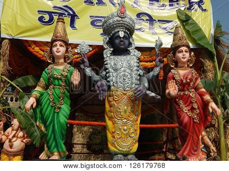 HYDERABAD,INDIA-APRIL 15:Idol of god venkateswara and his wives cow kuteeron a lorry during procession on sri rama navami festival on April 15,2016 in Hyderabad,India.