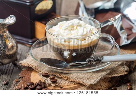 Glass Cup Of Coffee With Cream