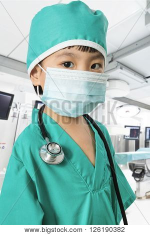 Asian Little Chinese Girl Playing A Doctor With Mask And Stethoscope