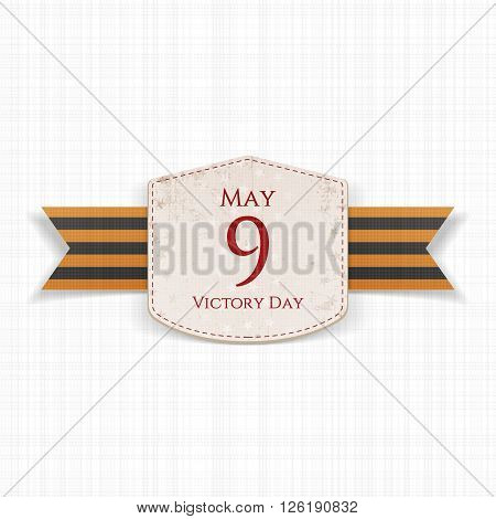Victory Day. May 9 realistic Label with st. George festive Ribbon on white textile Background. Vector Illustration