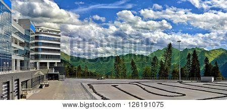 Panoramic view of mountains and carting track in Gazprom Laura ski resort in Krasnaya polyana Sochi Russia