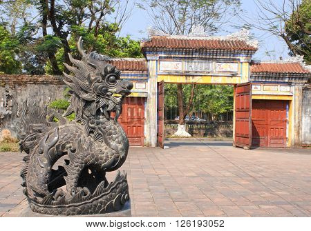 Iron dragon statue and entrance gate in forbidden city, Imperial palace, Hue, Vietnam. UNESCO world heritage site
