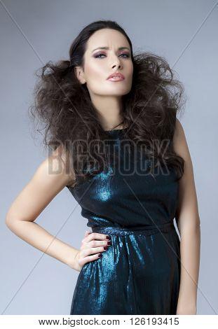Studio Portrait Of Young Beautiful Brunette Woman In Sequin Dress.