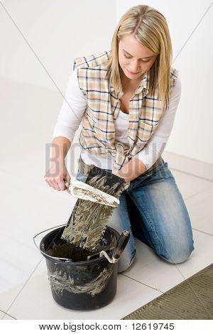 Home Improvement, Renovation - Handywoman Laying Tile